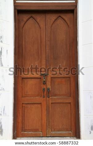 Wooden doors mansion - stock photo