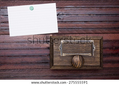 Wooden drawer old-style archive cabinet. Information card. - stock photo