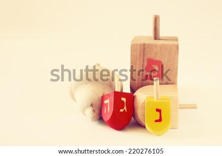 wooden dreidels for hanukkah (spining top) . filtered image - stock photo