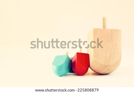 wooden dreidels (spinning top) for hanukkah jewish holiday . filtered image - stock photo