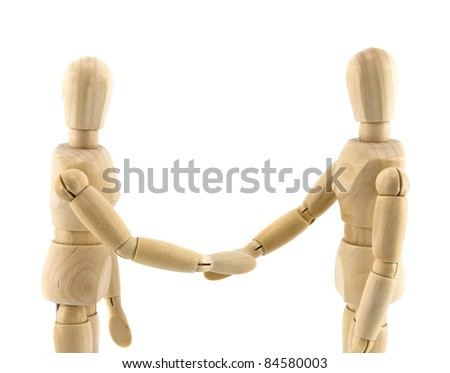 Wooden dummies shaking hands, Cooperation of business - stock photo