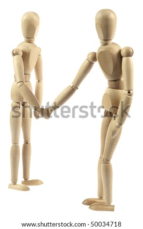Wooden dummies shaking hands isolated on white - stock photo