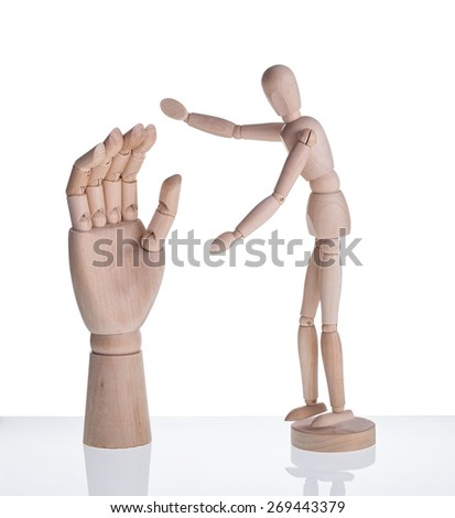Wooden dummy and a symbol of the hand prosthesis. On a white background. - stock photo