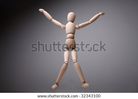 Wooden dummy posing - stock photo
