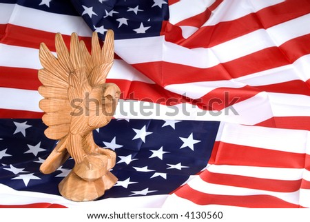 Wooden eagle statue on american flag.  Leadership, independence day concept.