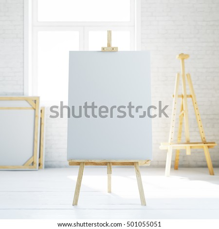 Wooden easel with blank white canvas in loft empty interior. 3d rendering