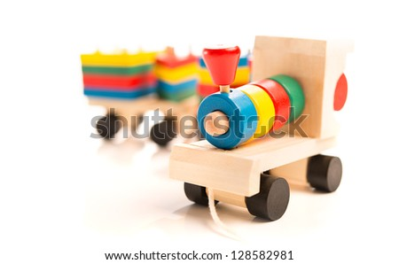 wooden educational toys. colorful train isolated on white background - stock photo