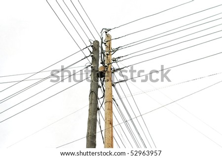 wooden electricity post against gray sky - stock photo