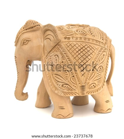 Wooden elephant sculpture isolated on white - stock photo