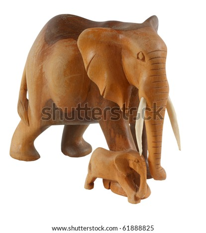 Wooden elephant with calf, isolated on background. - stock photo