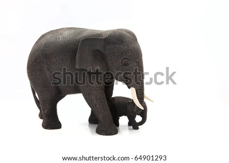 Wooden elephant with calf, isolated on white.