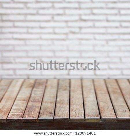 Wooden empty table with b - stock photo