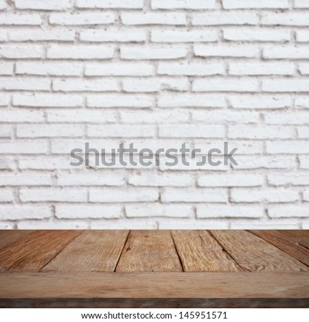 Wooden empty table with brick wall