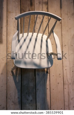 Wooden empty white chair, view from above.