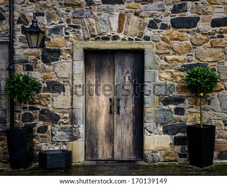 Wooden entrance door of an old house - stock photo