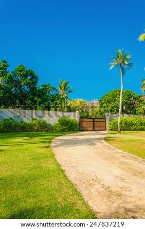Wooden entrance of a luxury luxury properties in exotic scenery - stock photo