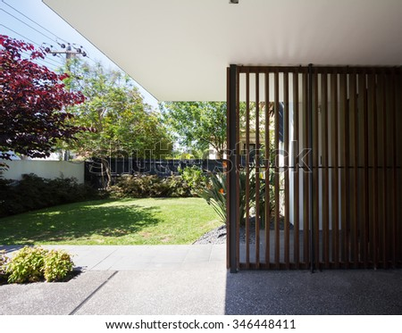 Wooden entry detail feature and front garden in contemporary Australian home - stock photo