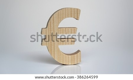 Wooden euro symbol on a white background