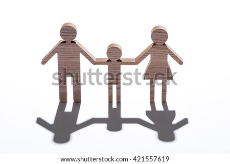 Wooden family. Family in love. Family care and unity concept. - stock photo