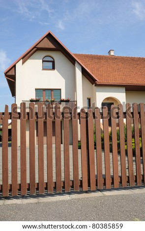 wooden fence around nice house
