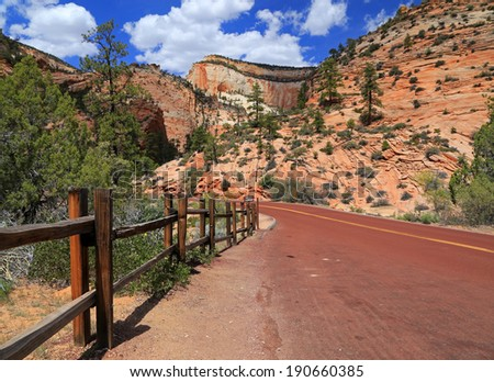 Wooden fence beside a parking spot in Zion National Park, Utah, USA. - stock photo