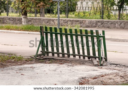 wooden fence blocking the way - stock photo