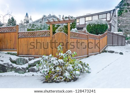 Wooden fence in cold,chilly and frosty winter time covered with snow . Vancouver, Canada. - stock photo