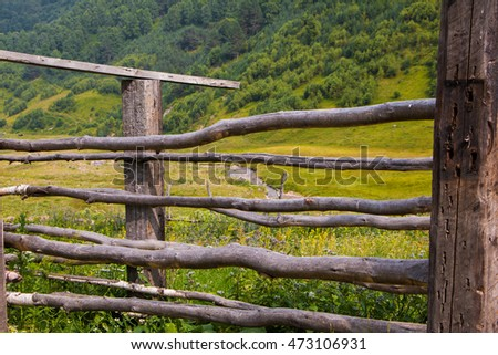 wooden fence in the village in the mountains