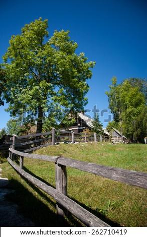 wooden fence leading to the mountain house, bohinj range, slovenia - stock photo