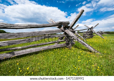Wooden Fence Manassas National Battlefield Park with Yellow Flowers - stock photo