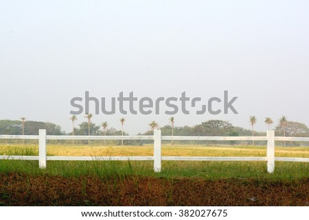 Wooden fence on farms and sky