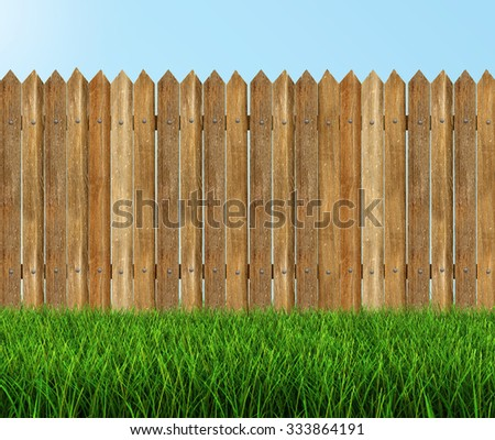 Wooden fence on grass (clipping path included)