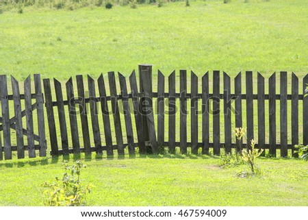 wooden fence on green grass background, rural scenery view