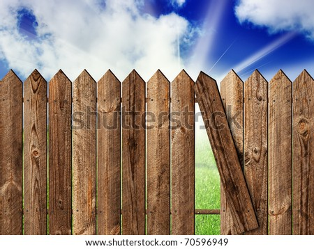 wooden fence over the backyard with sky and sun - stock photo