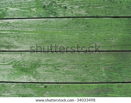 Wooden fence painted in green color