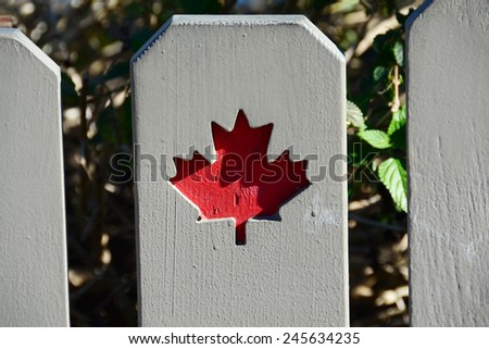 Wooden fence showing the Canadian symbol of the Maple Leaf - stock photo