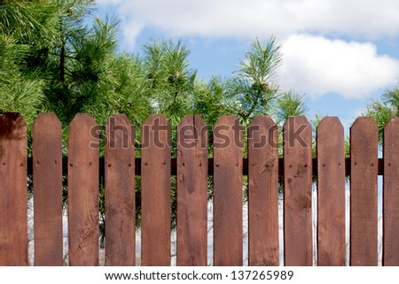 wooden fence, sky - stock photo
