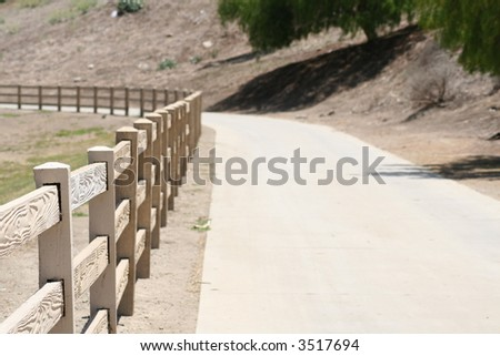 wooden fence that is curving - stock photo