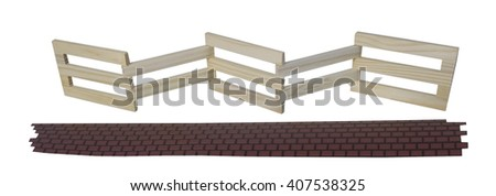 Wooden fence used to contain an area with brick walkway - path included - stock photo