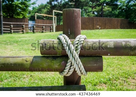 Wooden fence with a rope tied