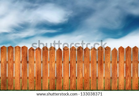 wooden fence with green grass and field on background - stock photo