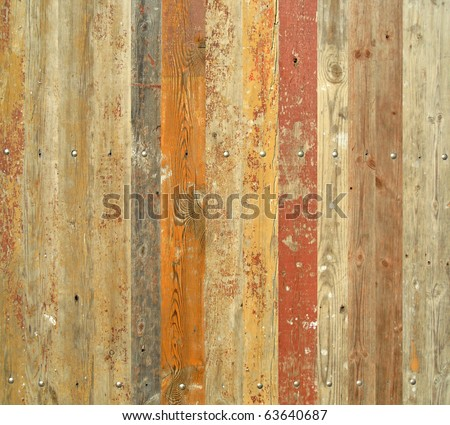 Wooden fence with paint traces - stock photo