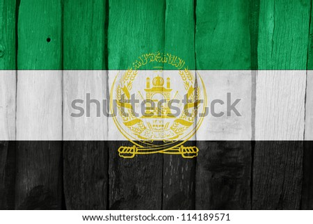Wooden fence with the flag of Afghanistan painted on it - stock photo