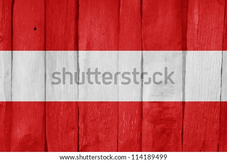 Wooden fence with the flag of Austria painted on it