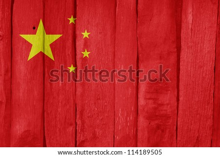 Wooden fence with the flag of China painted on it - stock photo