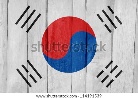 Wooden fence with the flag of South Korea painted on it - stock photo