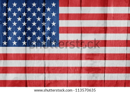 Wooden fence with the flag of United States of America painted on it