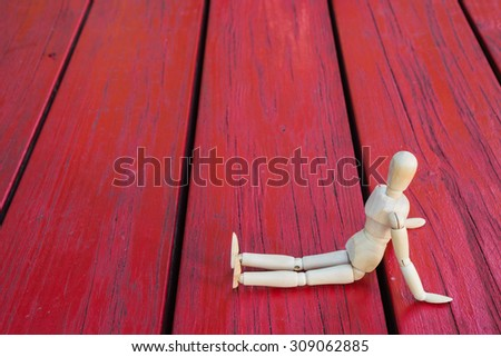 Wooden figure introduce thinking show and present - stock photo