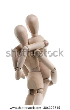Wooden figure is carrying another on their back, isolated on a white background.