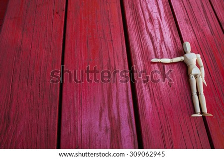 Wooden figure raising arm / hand and introduce/ show and present - stock photo